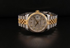 Silver Dial with Gold Dial Hour Markers and Gold Stick Hands