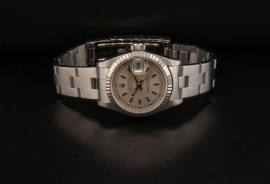 Silver Dial with Roman Numerals on Dial with Stick Hourmarkers and Hands