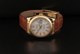 White Dial with Gold Lum Stick Hour Markers and Gold Lum Stick Hands